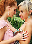 Denisa Heaven and Sasha Rose lick and tease in the garden