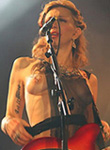 Courtney Love drunk and topless at stage