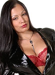 Vampire slayer Aria Giovanni slips out of her coat and strips