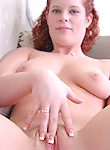 busty redhead chick playing with her tits and pussy