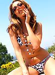 Jenna Haze strips naked in a string bikini and high heels