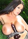 Busty babe Rebecca Jessop masturbating with dildo in garden