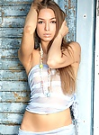 Heavenly girl with powdery skin and small breast, she has long hair and slowly strips away everything but her.
