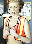 Jezebelle Bond is a slutty little traffic cop who wants to strip for you