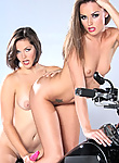 Tori Black and Bobbi Star posing and playing on top of a chopper